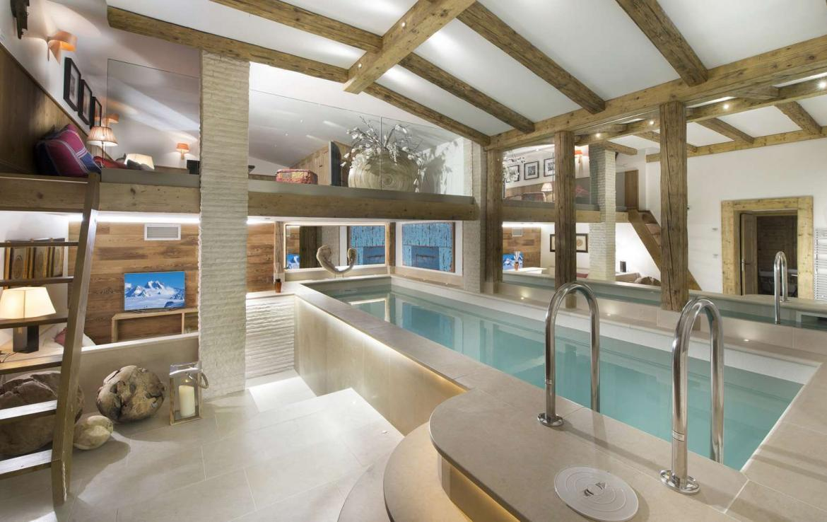 Kings-avenue-courchevel-sauna-hammam-swimming-pool-childfriendly-parking-cinema-kids-playroom-games-boot-heaters-fireplace-ski-in-ski-out-area-courchevel-089-6