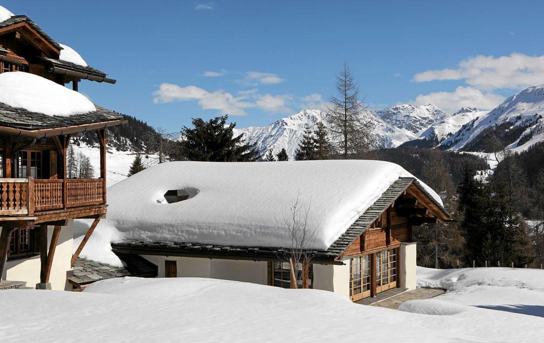 Kings-avenue-davos-sauna-jacuzzi-hammam-swimming-pool-parking-cinema-kids-playroom-boot-heaters-fireplace-ski-in-ski-out-wine-cellar-spa-massage-waterfall-area-davos-001-3
