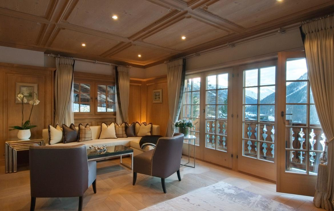 Kings-avenue-davos-sauna-jacuzzi-hammam-swimming-pool-parking-cinema-kids-playroom-boot-heaters-fireplace-ski-in-ski-out-wine-cellar-spa-massage-waterfall-area-davos-001-9