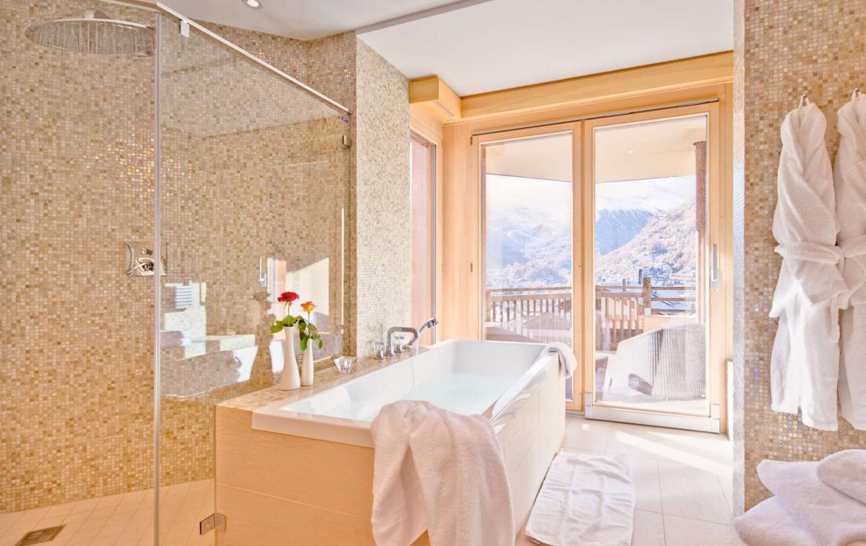 Kings-avenue-zermatt-wifi-sauna-jacuzzi-childfriendly-cinema-games-room-fireplace-pilates-yoga-room-balconies-area-zermatt-004-17