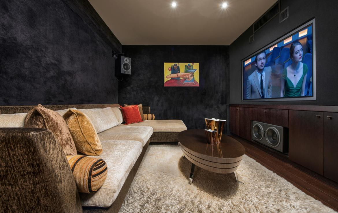 kings-avenue-luxury-chalet-courchevel-003-cinema-room-with-relaxation-area
