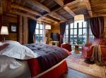 kings-avenue-luxury-chalet-courchevel-005-master-bedroom-with-tv-and-views