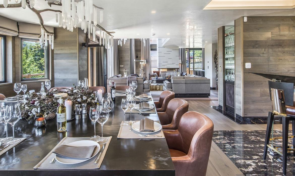 kings-avenue-luxury-chalet-courchevel-008-dining-area-with-dining-table-and-views