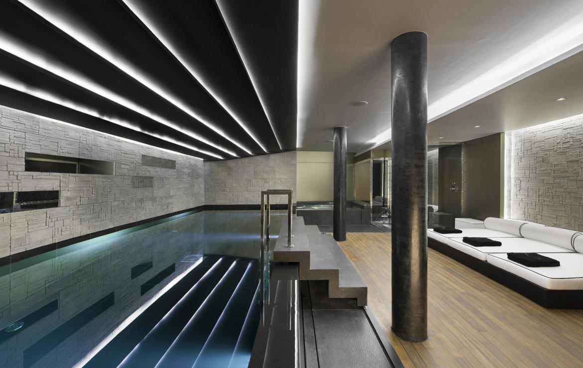 kings-avenue-luxury-chalet-courchevel-008-side-view-spa-area-with-indoor-swimming-pool-and-relaxation-area