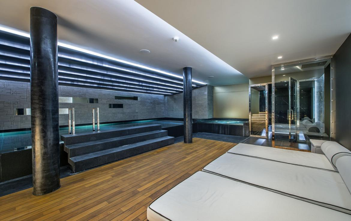 kings-avenue-luxury-chalet-courchevel-008-spa-area-with-indoor-swimming-pool