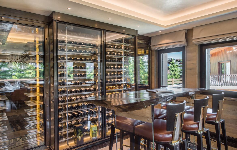 kings-avenue-luxury-chalet-courchevel-008-wine-cellar-outside-mountain-views