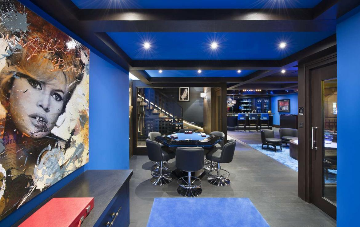 kings-avenue-luxury-chalet-courchevel-009-games-room-with-bar-area-and-sitting-area
