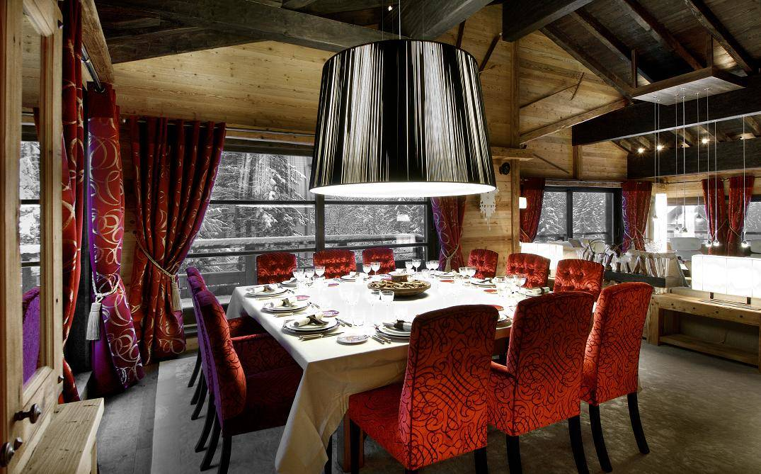 kings-avenue-luxury-chalet-courchevel-010-dining-room-with-dining-table-and-balcony