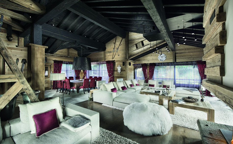 kings-avenue-luxury-chalet-courchevel-010-height-livingroom-with-sitting-room-and-dining-table-and-balcony