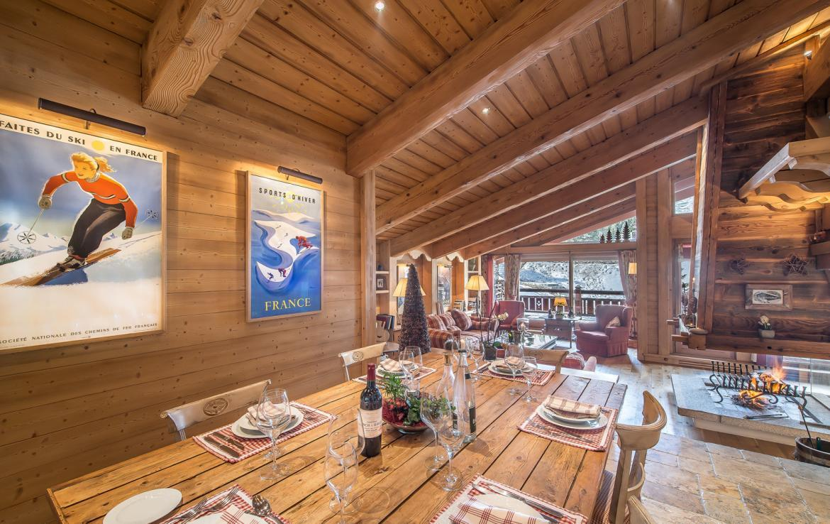 kings-avenue-luxury-chalet-courchevel-011-dining-room-with-sitting-room-at-background-with-mountain-views