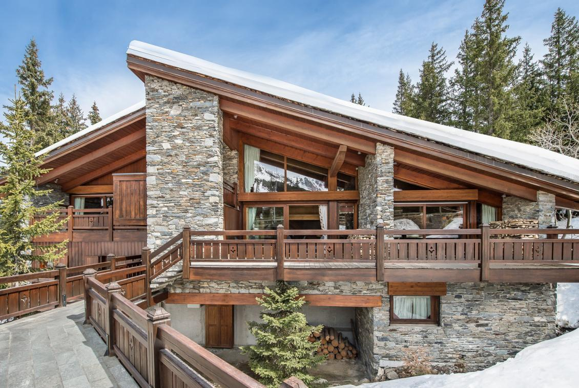 kings-avenue-luxury-chalet-courchevel-011-exterior-snow-blue-sky