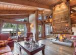 kings-avenue-luxury-chalet-courchevel-011-wooden-sitting-room-with-open-fireplace