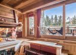 kings-avenue-luxury-chalet-courchevel-011-woorden-sitting-room-with-open-fireplace-and-mountain-views