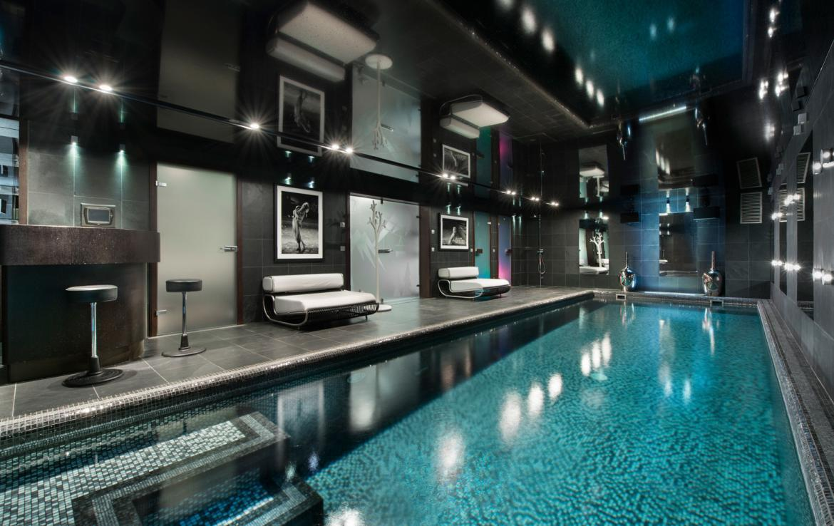 kings-avenue-luxury-chalet-courchevel-003-inside-swimming-pool-with-bar-area