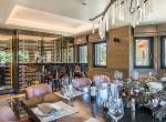 kings-avenue-luxury-chalet-courchevel-008-dining-area-with-wine-cellar