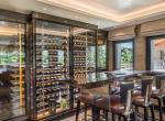 kings-avenue-luxury-chalet-courchevel-008-wine-cellar-outside-mountain-views