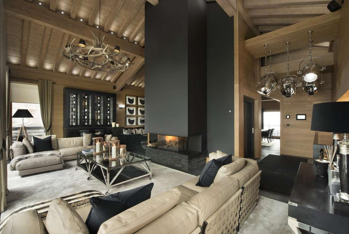 kings-avenue-luxury-chalet-courchevel-009-sitting-room-with-open-fireplace